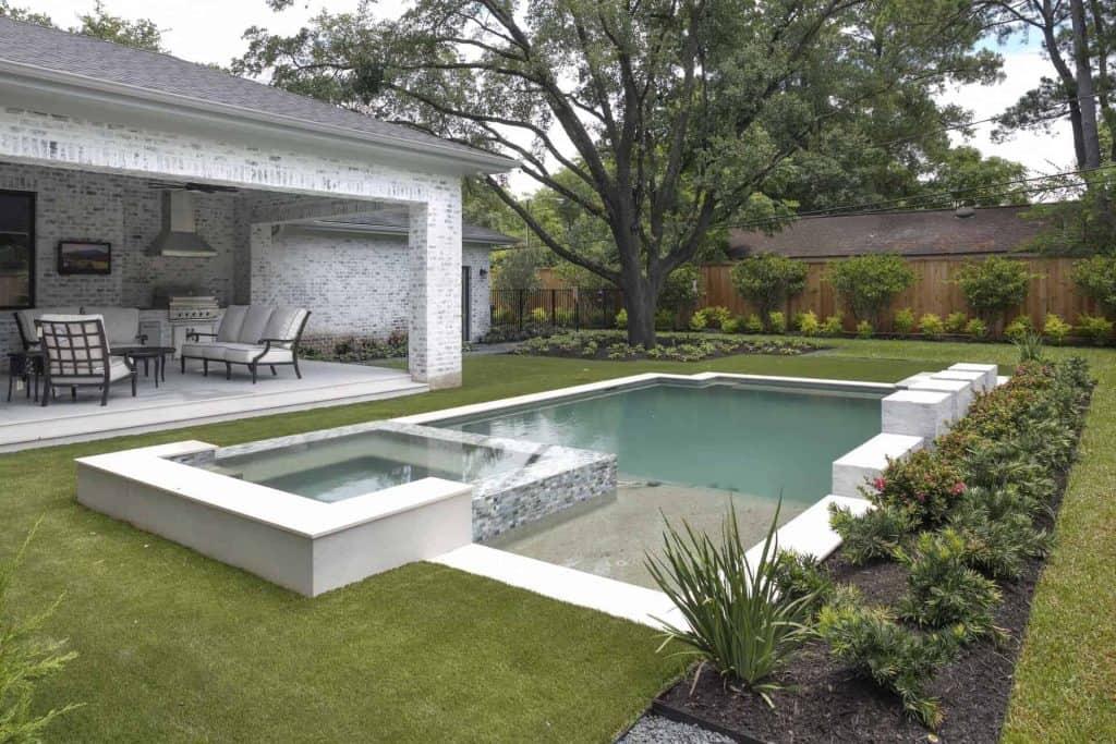 Farmhouse pool landscape fountain spa outdoor kitchen grill