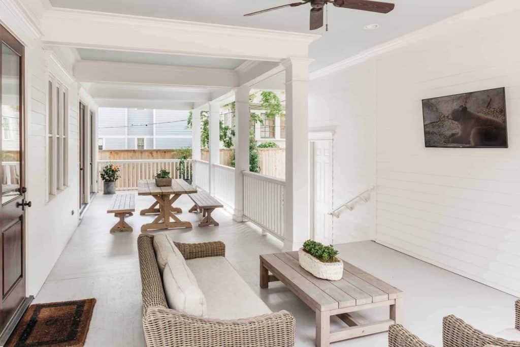 farmhouse-back-porch-tv-picnic-table